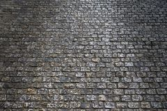 Old cobblestone street at night backlit background texture Stock Photo