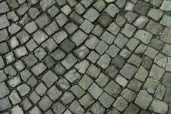 Old cobblestone on the street. Old vintage cobblestone on the street royalty free stock photo