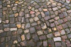 Old cobblestone on the street. Old vintage cobblestone on the street royalty free stock image