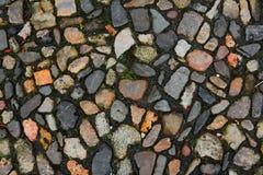 Old cobblestone on the street. Old vintage cobblestone on the street stock photos
