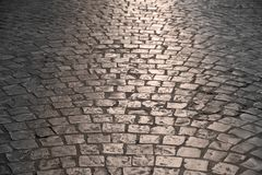 Old cobblestone street warm light background texture Royalty Free Stock Image