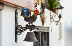 The old cock-bell that hung on the doors Stock Photo