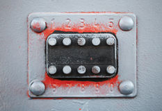 Old code lock with buttons on gray door Stock Photo