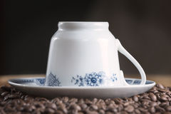 Old coffee cup with coffee beans Stock Photos