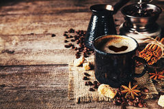 Old coffee cup and mill on dark rustic background Stock Photos