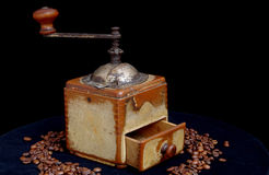 Old coffee grinder. And coffee beans royalty free stock image