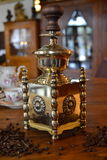 Old coffee grinder. Old antique coffee grinder with coffee beans Royalty Free Stock Photos