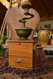 Old coffee grinder. Old antique coffee grinder with coffee beans Stock Photography