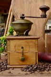 Old coffee grinder. Old antique coffee grinder with coffee beans Stock Image