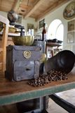 Old coffee grinder. Old antique coffee grinder with coffee beans Royalty Free Stock Images