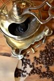 Old coffee grinder. Old antique coffee grinder with coffee beans Stock Photos