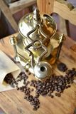 Old coffee grinder. Old antique coffee grinder with coffee beans Stock Photo