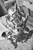 Old coffee grinder. Old antique coffee grinder with coffee beans, balck and white photo Stock Photo