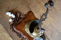 Old coffee grinder. Old antique coffee grinder with coffee beans and sugar Royalty Free Stock Photography