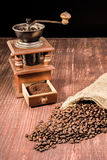 Old Coffee Grinder and Beans Stock Images