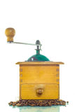 Old coffee grinder with beans. On white background Royalty Free Stock Image