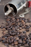 Old coffee grinder and coffee. Close up Stock Photo