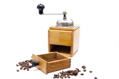 Old coffee grinder with coffee beans Royalty Free Stock Image