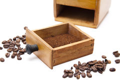 Old coffee grinder with coffee beans Stock Photography