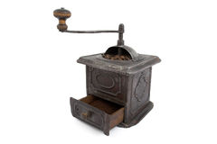 Old coffee grinder and coffee beans Royalty Free Stock Photo