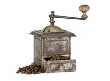 Old coffee grinder with coffee beans isolated. Antique coffee grinder filled with coffee beans isolated on white background Royalty Free Stock Photography