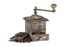 Old coffee grinder with coffee beans isolated. Antique coffee grinder filled with coffee beans isolated on white background Stock Photos