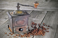 Old coffee grinder with coffee beans Stock Image