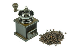 Old coffee grinder and coffee beans on white background. Stock Photos