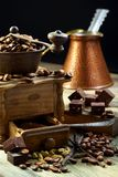 Old coffee grinder and coffee with cardamom. Royalty Free Stock Images