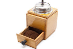Old coffee grinder with coffee ground Royalty Free Stock Photo