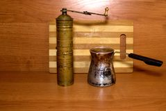 Old coffee grinder and coffee maker. Antiques Royalty Free Stock Photos