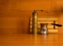 Old coffee grinder and coffee maker. Antiques Royalty Free Stock Image