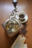 Old coffee grinder. With cup Royalty Free Stock Image