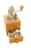Old coffee grinder with money Stock Photography
