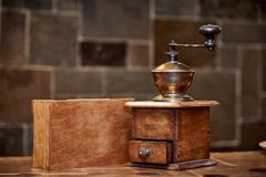 The old coffee grinder. Stands on the table next to the box Stock Photo