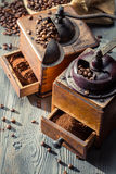 Old coffee grinders with burlap sack stock images