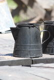 Old coffee kettle. Old black tin coffee kettle on table Stock Photos