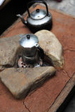 Old coffee kettle on ancient style of cooking stove Royalty Free Stock Photo