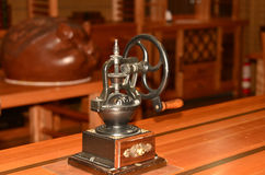Old Coffee machine on wooden table Royalty Free Stock Images
