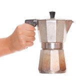 Old Coffee Maker. Hand holding an old italian mocha coffee maker Stock Image