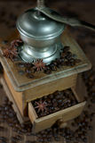 Old coffee mill. With coffee beans and star anise. Selective focus Stock Images