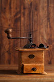 Old coffee mill with coffee beans, close-up. Nostalgic coffee grinder with Ground Coffee  and Whole Coffee Beans Royalty Free Stock Photography