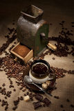 Old coffee mill and cup of coffee Royalty Free Stock Photo