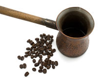 Old Coffee pot with coffee beans Royalty Free Stock Photo