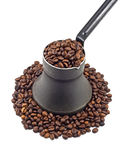 Old coffee pot with coffee beans. Isolated on white Stock Photo