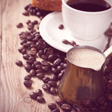 Old coffee pot and cup on wooden rustic background Royalty Free Stock Images