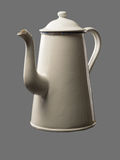 Old coffee pot isolated on grey Backdrop Royalty Free Stock Photo