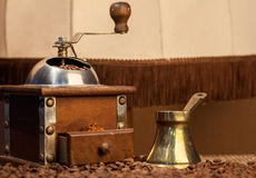 Old coffee pot and mill on dark rustic background Royalty Free Stock Photography