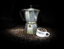 Old coffeepot with cup and coffee beans Stock Image