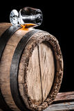Old cognac matured in oak barrel Stock Photography